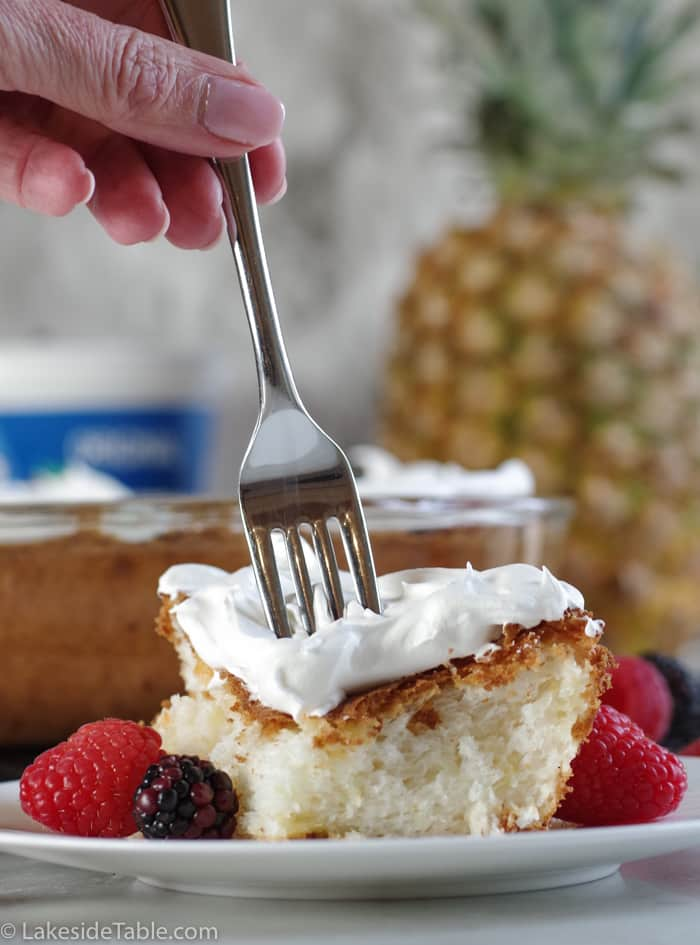 single piece of pineapple angel food cake with fork