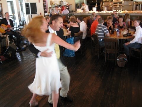 father and daughter dancing in the firefly grill
