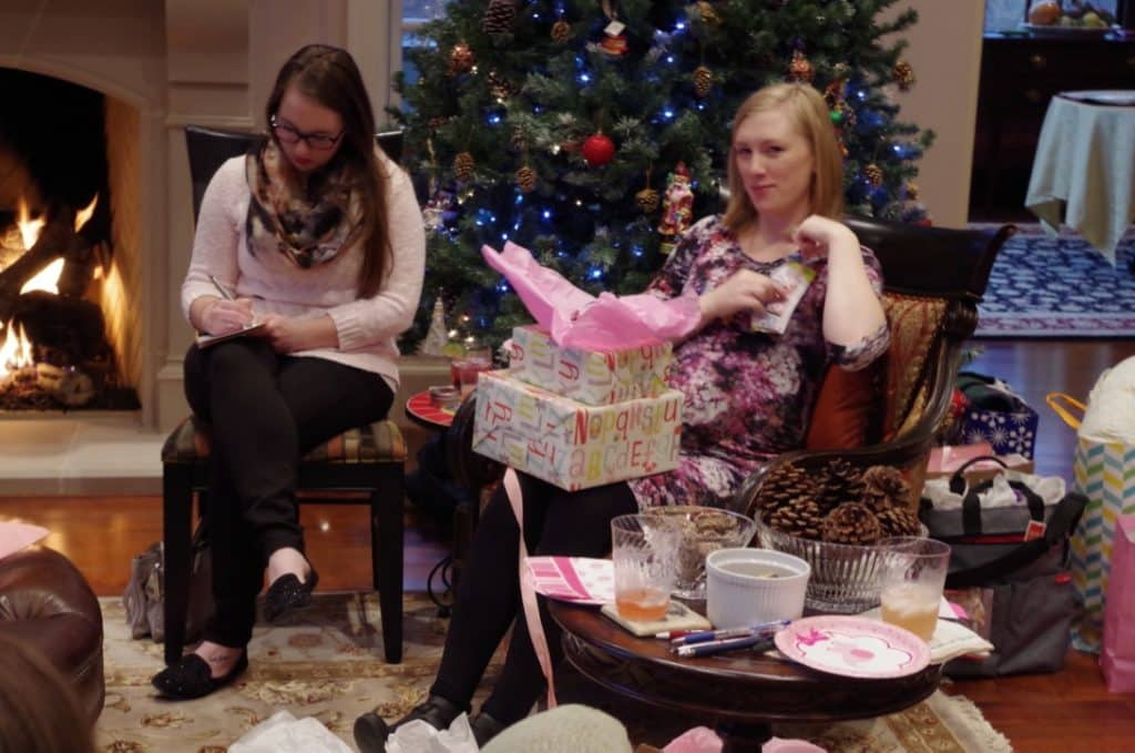 ashley opening her baby shower gifts with sister Danielle