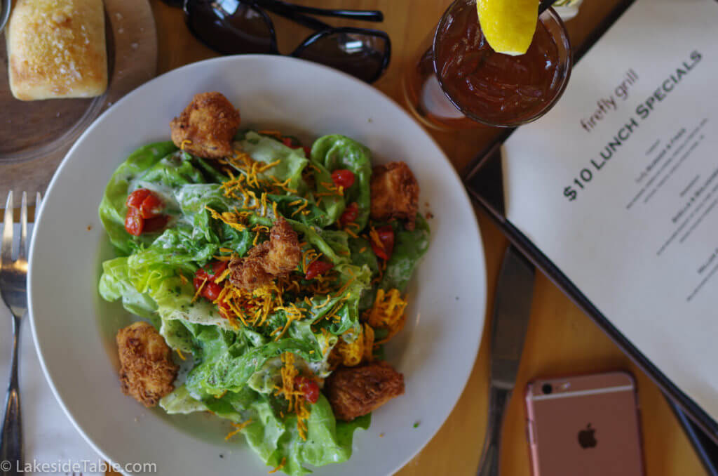 top down view of salad with fried chicken