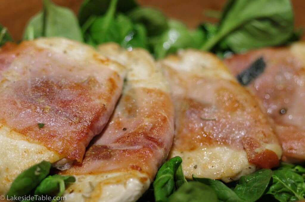 Saltimbocca Recipe - Jump in Your Mouth divine! Juicy tender chicken breast wrapped in prosciutto and smothered in cheese and mushroom sauce. Divine! | www.lakesidetable.com