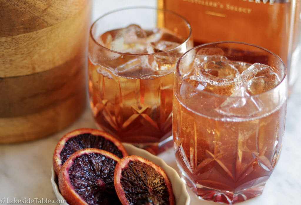 Old Fashion Cocktail Recipe - Put a little twist on a classic by using blood oranges and black maraschino cherries. So refreshing! | www.lakesidetable.com