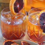 Old Fashioned Cocktail Recipe - Put a little twist on a classic by using blood oranges and black maraschino cherries. So refreshing! | www.lakesidetable.com