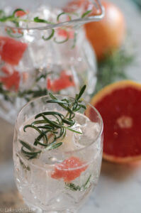 Grapefruit Rosemary Tonic Recipe - Seasonal grapefruit with fresh rosemary creates a light bubbly drink. Perfect for holiday entertaining and super EASY! | www.lakesidetable.com