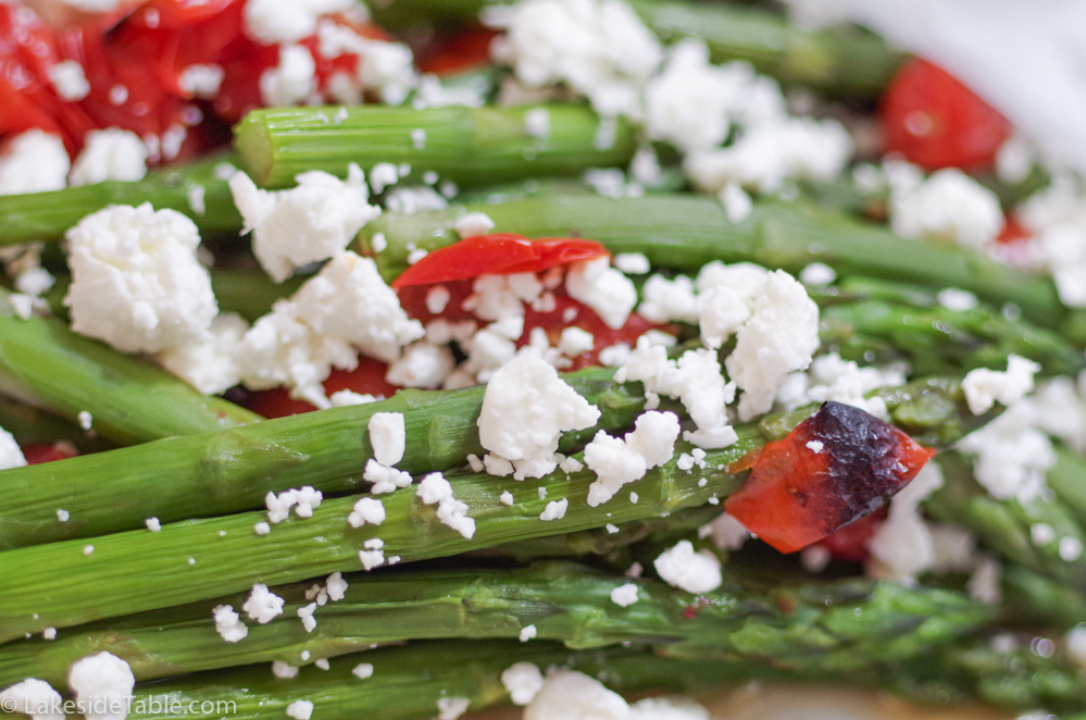 Braised green asparagus with white feta cheese and charred cherry tomatoes