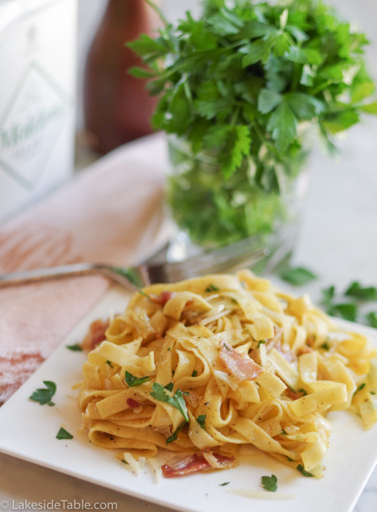 plated fettuccini carbonara with parsley on top