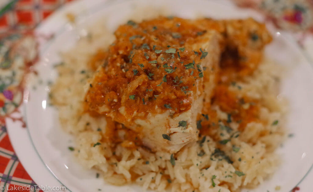 this red sauced chicken over rice has tons of paprika in it that really compliments an apricot tart dessert
