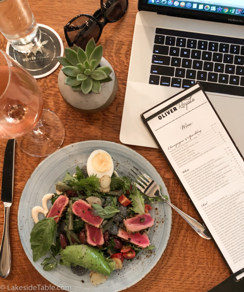 Nicoise Salad, with wine and computer at the Royale Restaurant in Knoxville