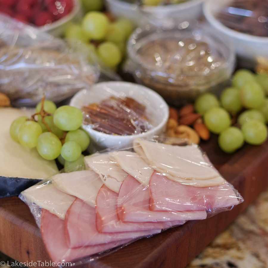 Small charcuterie meats covered in plastic