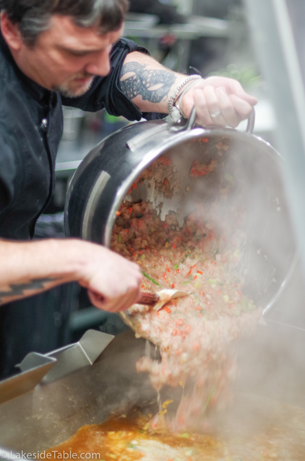 """Chef is Pouring the """"raft"""" into a giant vat of duck stock."""