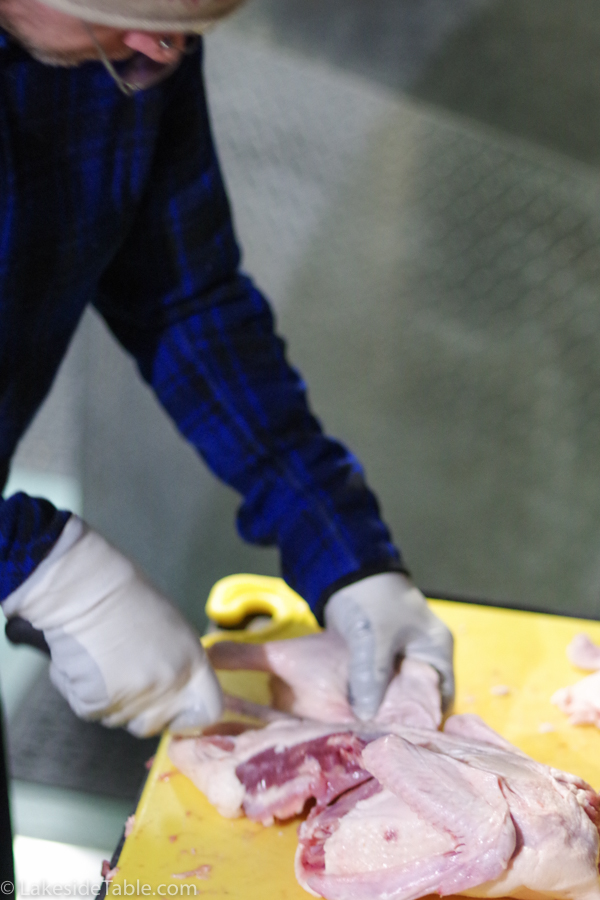 man cutting up duck breasts