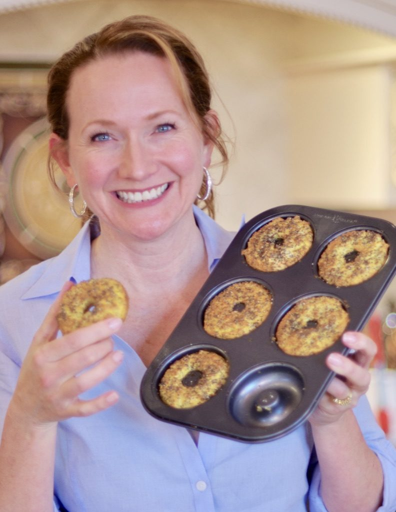 Madalaine holding a low carb keto bagel and bagel pan