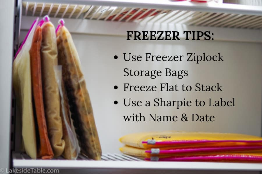 Soups on freezer shelf laying flat and stacked liked books on a library shelf after they have been frozen flat