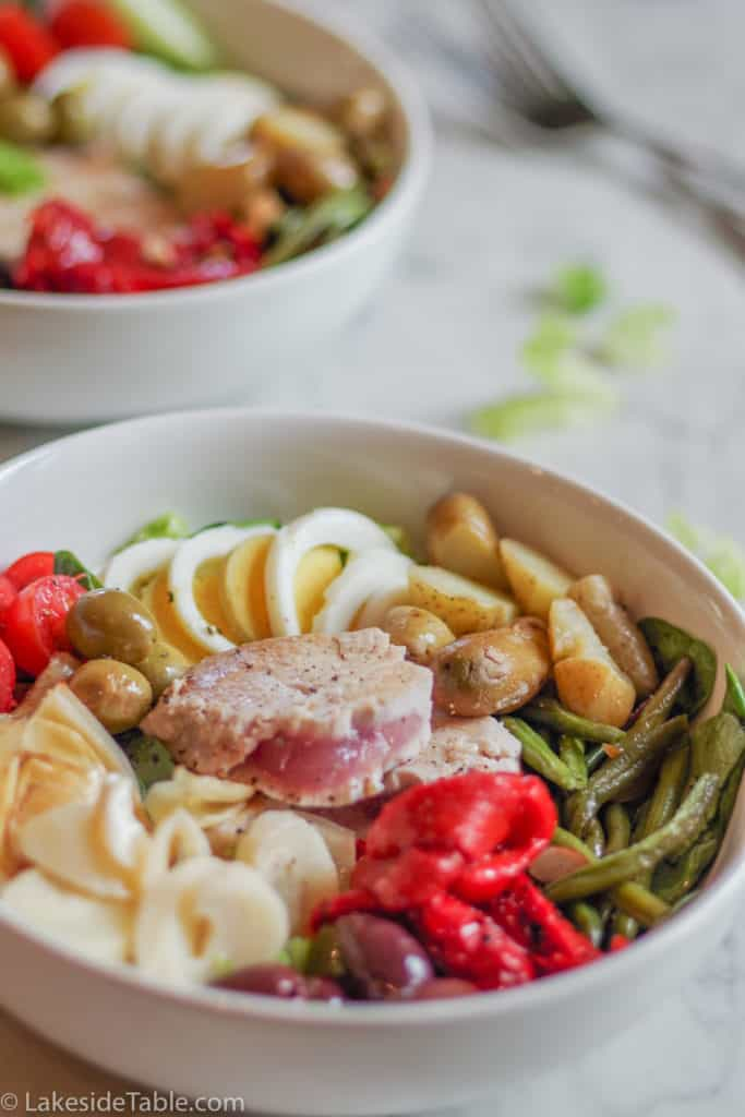Classic Nicoise Salad in white bowls