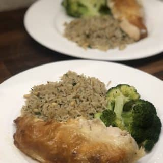 plate of roasted chicken, rice pilaf and steamed broccoli