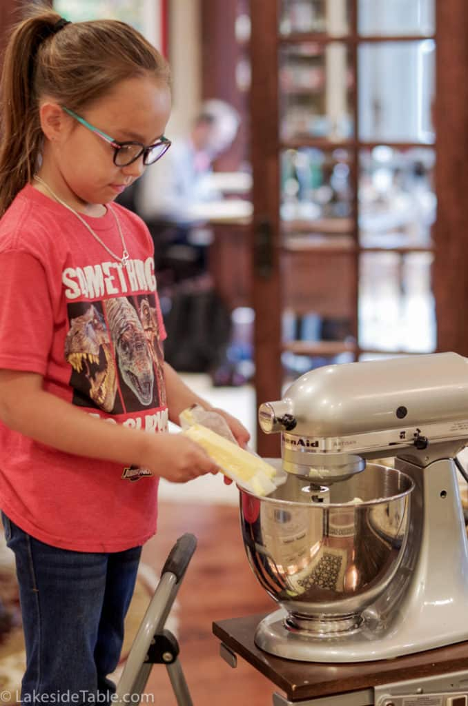 Rylin putting the butter in the mixer.