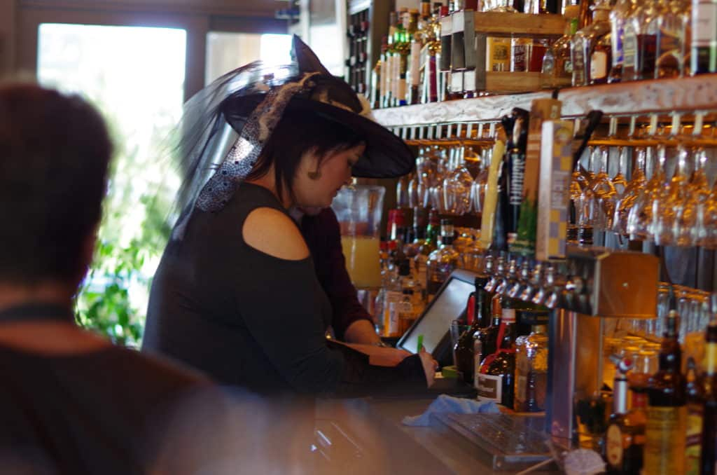Katie behind the bar at the firefly during witchfest