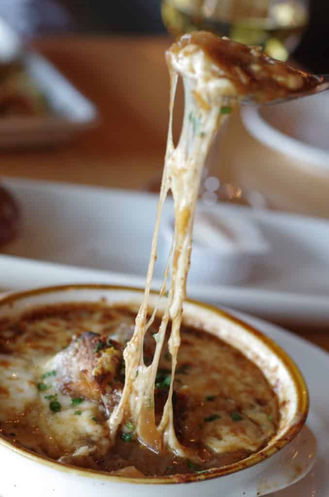 easy French onion soup with beef broth topped with cheese, parsley and garlic from the firefly grill effingham il