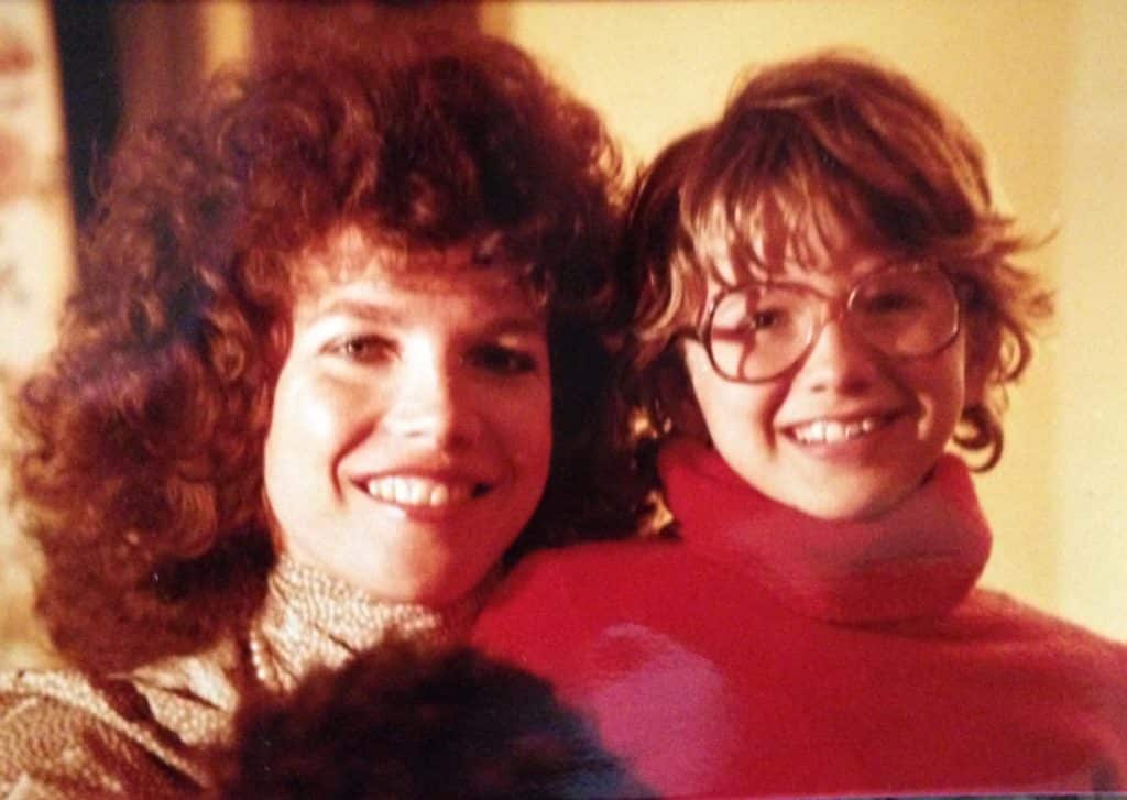 mother with lots of curly hair and daughter about 9 with messy short hair and glasses