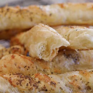 close up of flakey inside garlic parmesan bread twists made with puff pastry