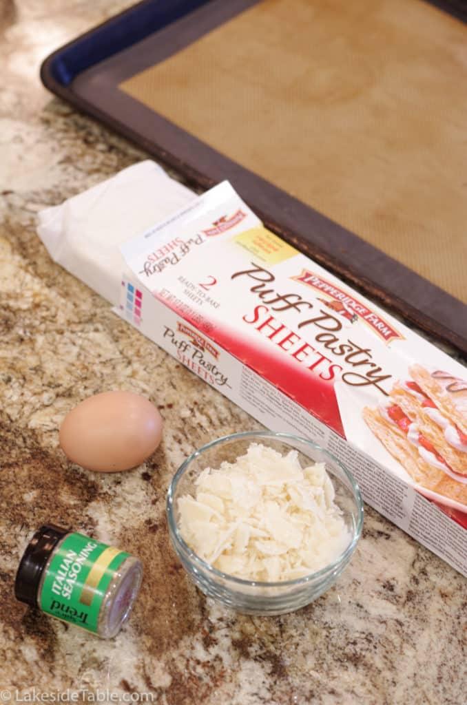 5 simple ingredients for garlic parmesan breadsticks: puff pastry, egg, parmesan cheese, italian seasoning and garlic salt