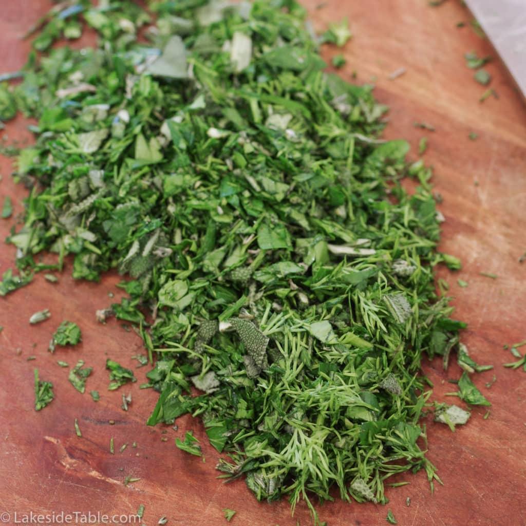 chopped herbs on cutting board