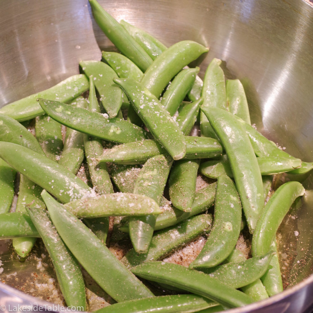 raw light green sugar snap peas in pot
