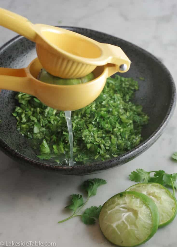 squeezing lime juice into chimichurri