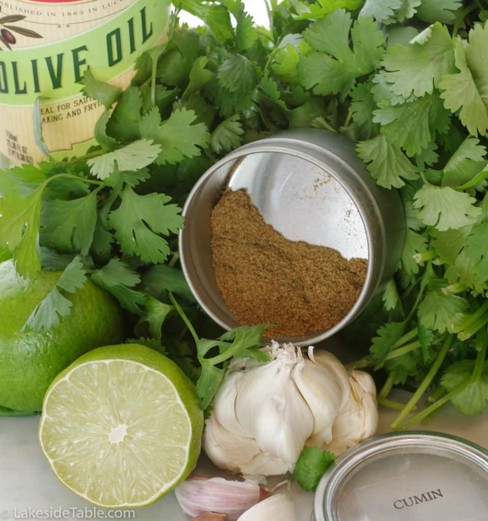 Ingredients for sauce: cilantro, cumin, garlic, lime & olive oil