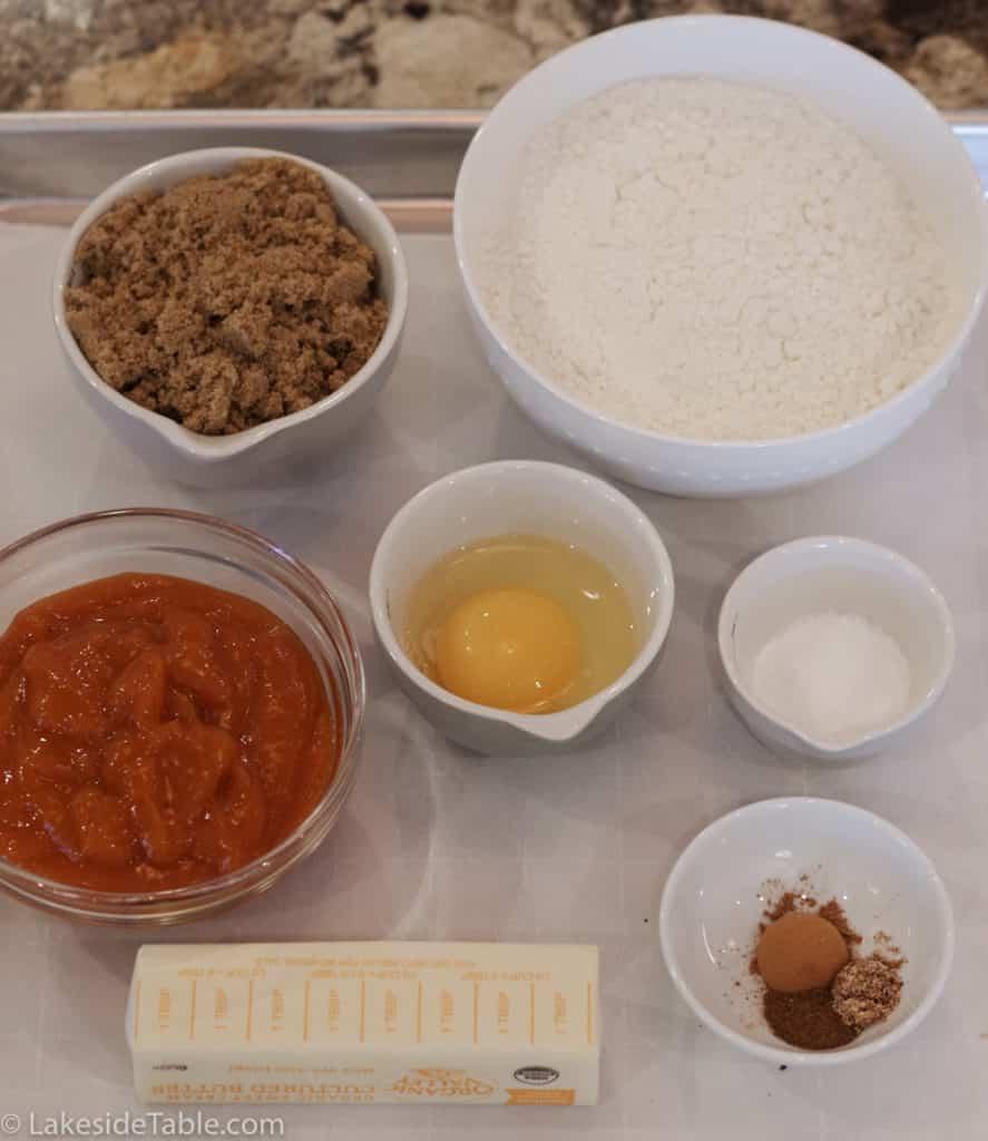 Persimmon cookie recipe ingredients: brown sugar, flour, baking soda, salt, egg, nutmeg, cinnamon, clove, persimmon pulp, butter