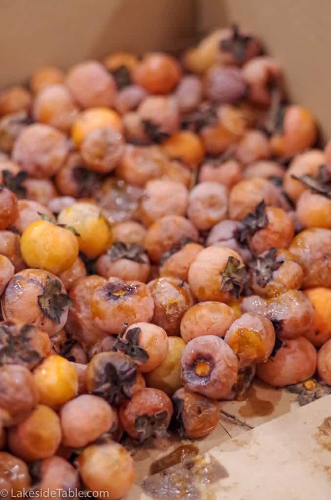 box of ripe fresh American persimmons