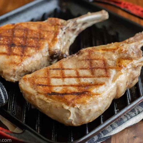 sous vide pork chops being finished in a grill pan