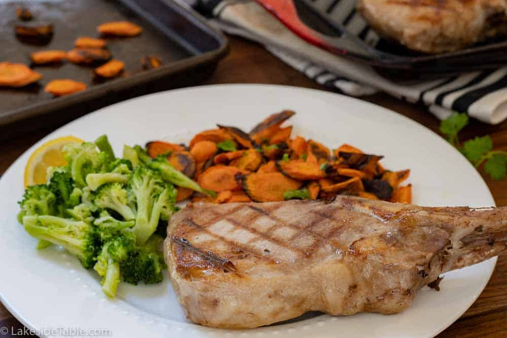 plated sous vide pork chops with broccoli and roasted carrots