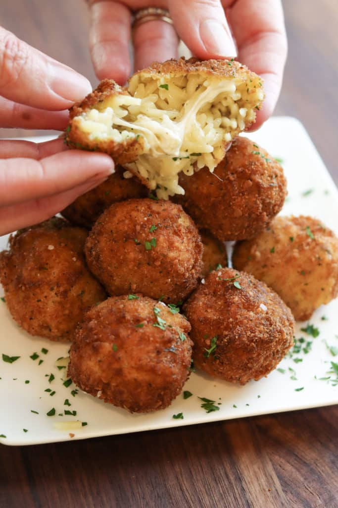 Fried mac and cheese balls opening to show inside